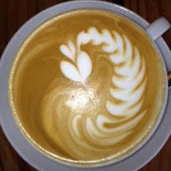 Creamer Swirling in Coffee
